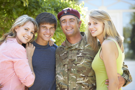 coming home: Portrait Of Soldier Returning Home WithTeenage Family