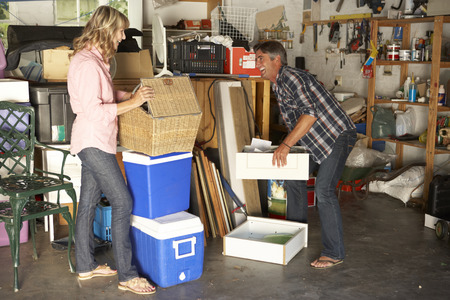 cleaning: Couple Clearing Garage For Yard Sale Stock Photo