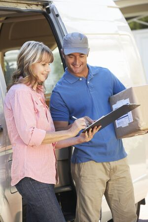 courier: Woman Signing For Packager Delivered By Courier