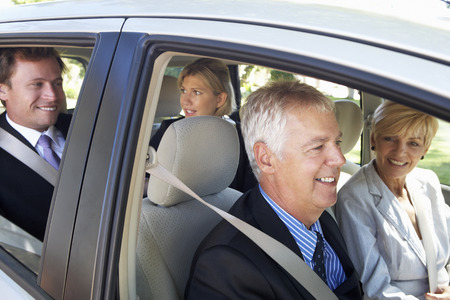 Group Of Business Colleagues Car Pooling Journey Into Work