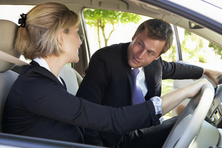 Two Business Colleagues Car Pooling Journey Into Work