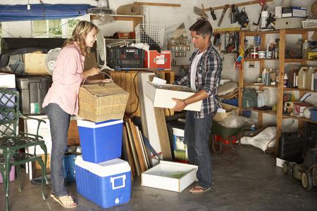 Couple Clearing Garage For Yard Sale Standard-Bild