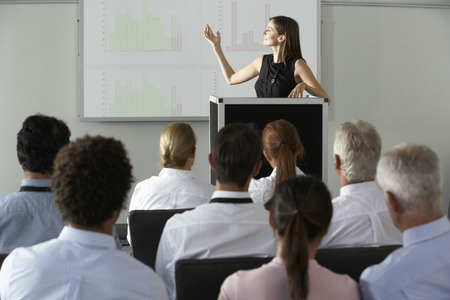 conference presentation: Businesswoman Delivering Presentation At Conference