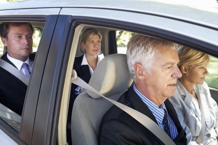 Group Of Business Colleagues Car Pooling Journey Into Work Stock Photo - 42164606