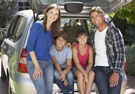 10 year old: Family Sitting In Trunk Of Car Stock Photo