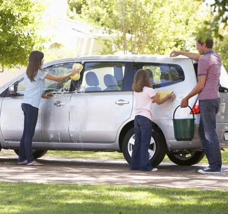 Father And Daughters Washing Car Together