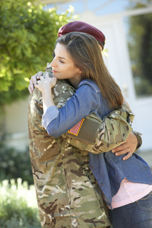 soldier: Soldier Returning Home And Greeted By Wife Stock Photo