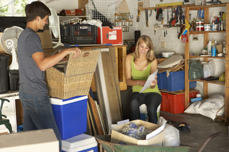 mess: Two Teenagers Clearing Garage For Yard Sale