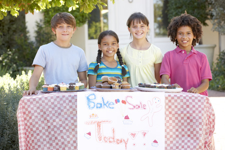 9 year old girl: Group Of Children Holding Bake Sale