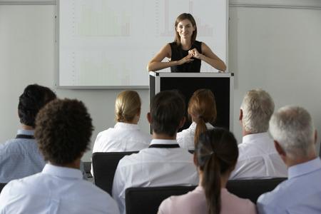 presentations: Businesswoman Delivering Presentation At Conference