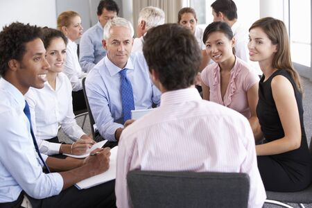 mixed age range: Businesspeople Seated In Circle At Company Seminar