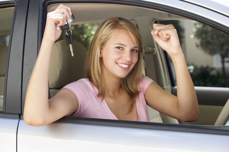 owning: Teenage Girl Celebrating Owning First Car Stock Photo