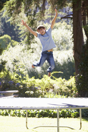 messing: Young Boy Having Fun On Trampoline