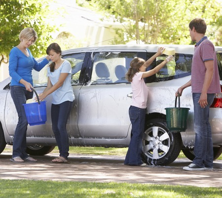 wash car: Family Washing Car Together Stock Photo