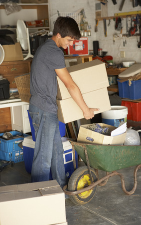 clearing: Teenage Boy Clearing Garage For Yard Sale