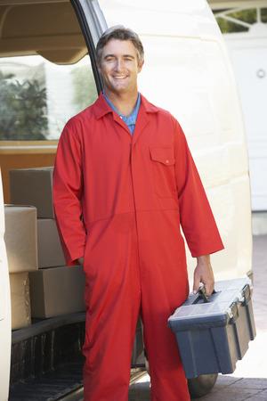boilersuit: Portrait Of Repairman Arriving In Van Stock Photo