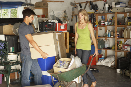 garage sale: Two Teenagers Clearing Garage For Yard Sale