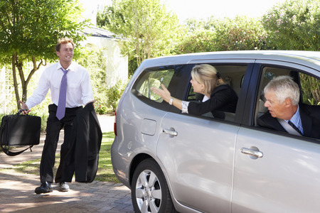 Businessman Running Late To Meet Colleagues Car Pooling Journey Into Work