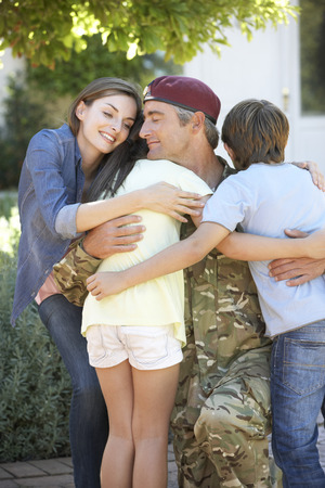 coming home: Soldier Returning Home And Greeted By Family