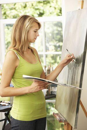 teenage girl: Teenage Girl Working On Painting In Studio Stock Photo
