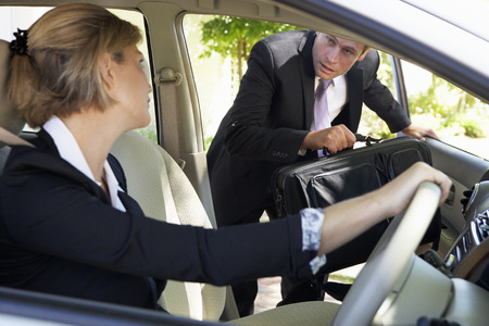 Businessman Late For Car Pooling Journey Into Work