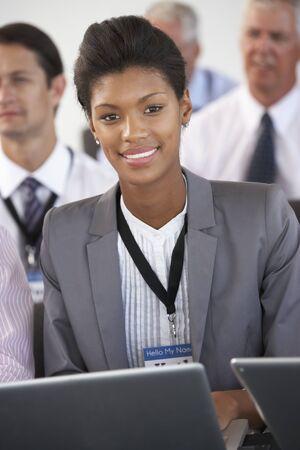 delegate: Male Delegate Listening To Presentation At Conference making Notes On Digital Tablet