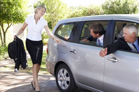 Businesswoman Running Late To Meet Colleagues Car Pooling Journey Into Work