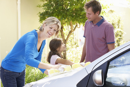 car carrier: Family Washing Car Together Stock Photo
