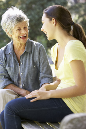teenage girl: Grandmother Talking With Teenage Granddaughter On Bench