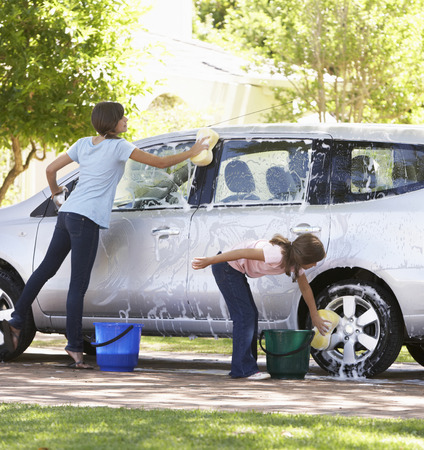 Two Girls Washing Car Together