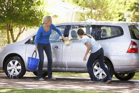 washing car: Mother And Teenage Daughter Washing Car Together