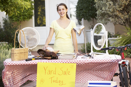 yard sale: Teenage Girl Holding Yard Sale Stock Photo