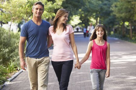 10 year old: Family Walking Through Summer Park