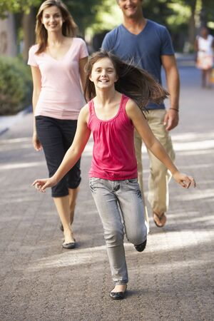 10 year old: Daughter Runs Ahead Of Parents On Walk Through Summer Park