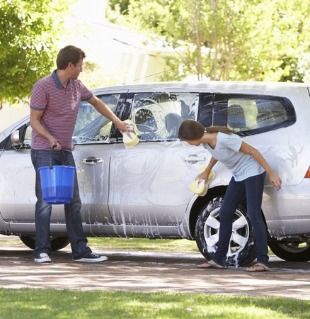clean car: Father And Teenage Daughter Washing Car Together
