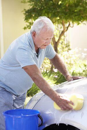 washing car: Senior Man Washing Car In Drive Stock Photo