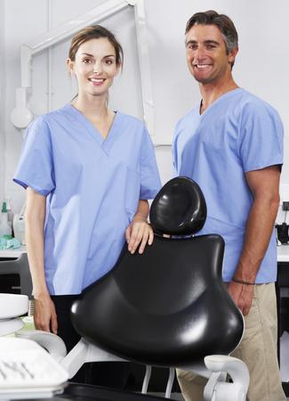 hygeine: Portrait Of Dentist And Nurse In Surgery