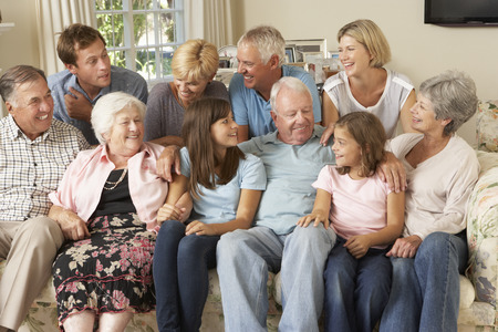 large family: Large Family Group Sitting On Sofa Indoors