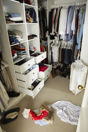 walk in closet: Untidy Teenage Bedroom With Messy Wardrobe Stock Photo