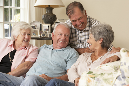 women friendship: Group Of Retired Friends Sitting On Sofa At Home Together