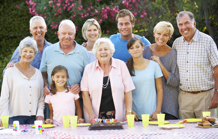 Large Family Group Celebrating Birthday Outdoors 版權商用圖片