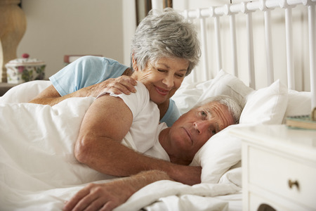 insomniac: Senior Man Having Difficulty In Sleeping In Bed With Wife