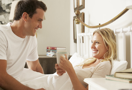 hot wife: Husband Bringing Wife Hot Drink In Bed At Home