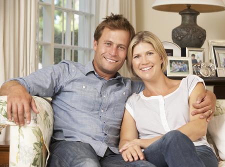indoors: Couple Sitting On Sofa Indoors