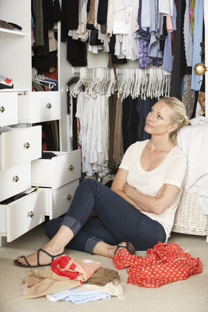 walk in closet: Teenage Girl Choosing Clothes From Wardrobe In Bedroom