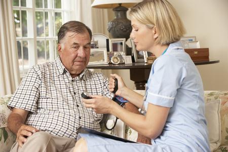 health check: Retired Senior Man Having Health Check With Nurse At Home