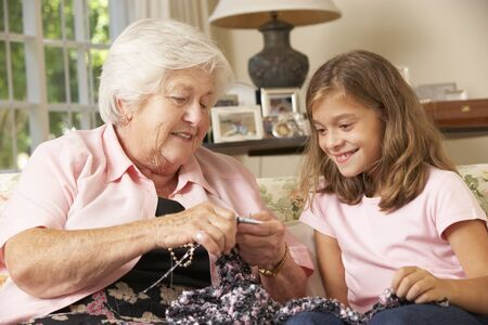 knitting: Grandmother Showing Granddaughter How To Knit At Home