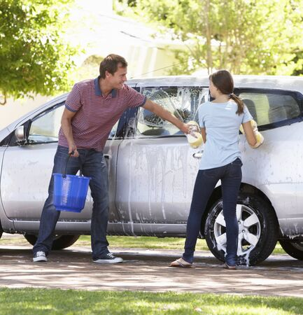 washing car: Father And Teenage Daughter Washing Car Together