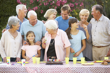 multi generation family: Large Family Group Celebrating Birthday Outdoors Stock Photo