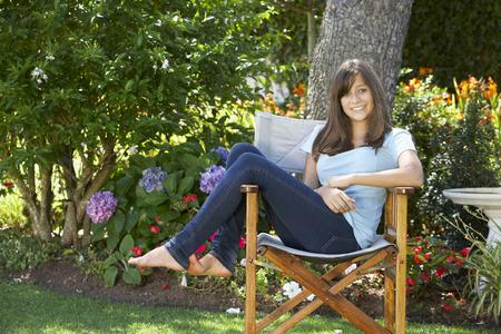 cute teen: Teenage Girl Sitting Outdoors In Garden Chair